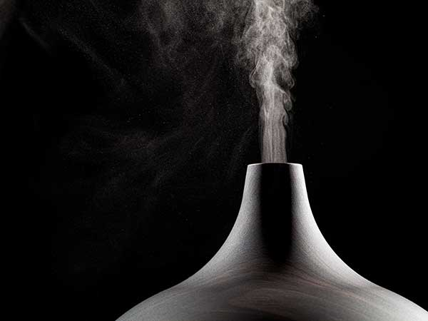 Close up of an ultrasonic aromatherapy oil diffuser in use.