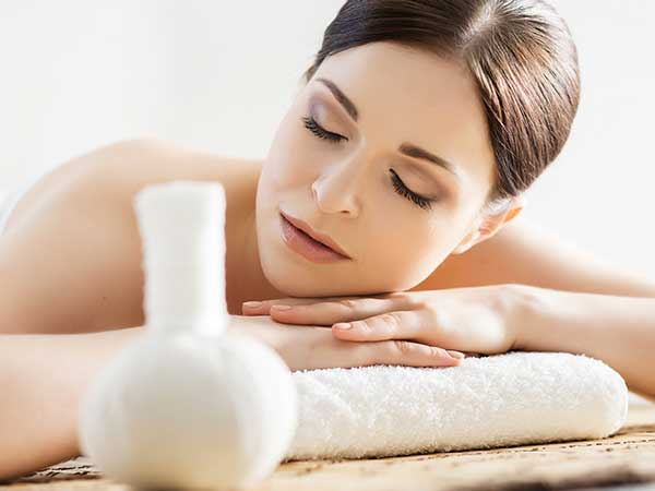 Woman using aromatherapy for stress at spa.