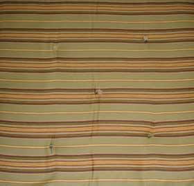 close-up of green and brown stripped mattress
