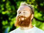 Man with red beard getting sunshine outdoors.