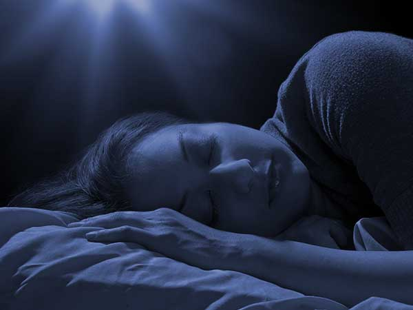 Woman Sleeping under blue light.
