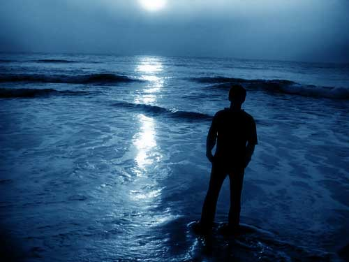 Parasomnias - Man Walking on Beach Under Blue Moonlight