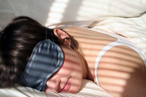 Lady wearing sleep eye mask