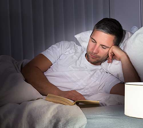 Man reading before bed