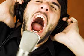 Man singing into microphone.