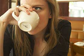 Woman drinking cup of coffee.